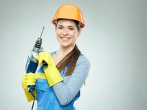 Smiling woman builder wearing protect helmet and uniform holding Stock Images