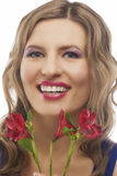 Smiling woman with bunch of flowers Stock Photo