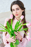 Smiling woman with bunch of tulips Stock Image