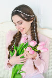 Smiling woman with bunch of tulips Royalty Free Stock Photos
