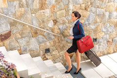 Smiling woman business going traveling baggage leaving. Smiling woman business going traveling baggage shoulder bag leaving Royalty Free Stock Image