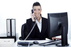 Smiling woman busy over phone Stock Photo