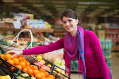 Smiling Woman Buying Dairy Products In Supermarket Royalty Free Stock Image