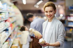 Smiling Woman Buying Milk Products Royalty Free Stock Photo