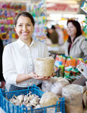 Smiling  woman buys the seeds in bag Stock Images