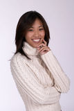 Smiling woman in cableknit sweater royalty free stock photography