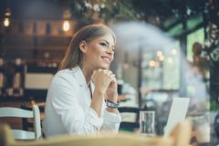 Smiling woman at cafe. stock photography