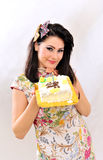 Smiling woman with a cake Royalty Free Stock Images