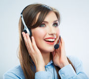 Smiling woman call center operator touching headsed. Close up b Royalty Free Stock Photography