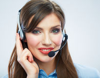 Smiling woman call center operator touching headsed. Close up b Stock Photography