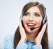 Smiling woman call center operator touching headsed. Close up b Stock Image