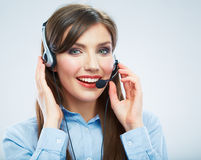 Smiling woman call center operator touching headse Royalty Free Stock Images