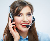 Smiling woman call center operator touching headse Royalty Free Stock Photo