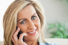 Smiling woman calling someome with her mobile phone Stock Image