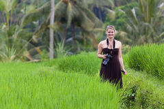 Smiling Woman with Camera in Bali Rice Field Stock Photos