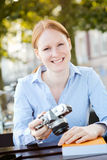 Smiling Woman with Camera and a Book Royalty Free Stock Images