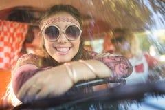 Smiling woman in camper van seen through windshield Royalty Free Stock Image