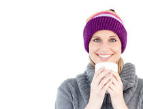 Smiling woman with cap and cup of coffee Stock Photo