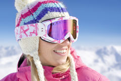 Smiling woman in cap and goggles Royalty Free Stock Images