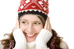Smiling woman with cap and scarf holding cheeks Stock Image