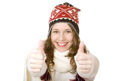 Smiling woman with cap and scarf shows both thumbs Stock Photo