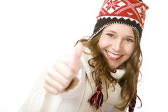 Smiling woman with cap and scarf shows thumb up Stock Image