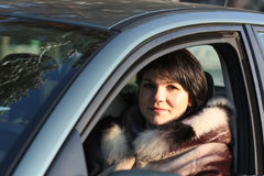 Smiling woman in car Royalty Free Stock Photography