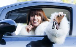 Smiling woman with car key Royalty Free Stock Image