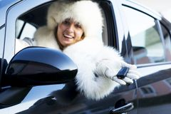 Smiling woman with car key Stock Images