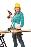 Smiling woman carpenter Stock Photo