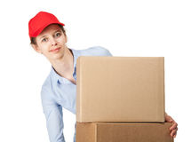 Smiling woman carrying big boxes Royalty Free Stock Photos