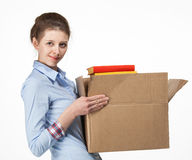 Smiling woman carrying a box with books Stock Images