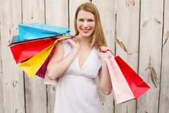 Smiling woman carrying shopping bags over her shoulder Royalty Free Stock Photo