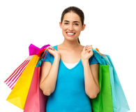 Smiling Woman Carrying Shopping Bags Stock Photography