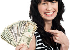 Smiling woman with cash Stock Photo