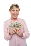 Smiling woman with cash Stock Images