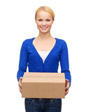 Smiling woman in casual clothes with parcel box Stock Photo