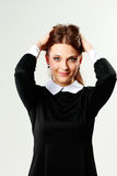 Smiling woman in casual dress touching her head Royalty Free Stock Photos