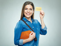 Smiling woman casual dressed shows golden credit card. Isolated portrait Stock Photos