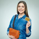 Smiling woman casual dressed shows golden credit card. Isolated portrait Stock Photography