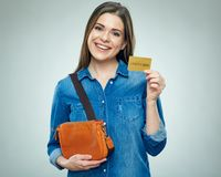 Smiling woman casual dressed shows golden credit card. Isolated portrait Royalty Free Stock Images