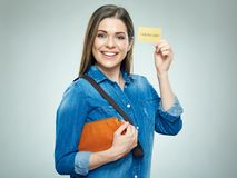 Smiling woman casual dressed shows golden credit card. Portrait Stock Photo