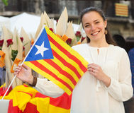 Smiling woman with Catalan Flag  in Royalty Free Stock Images