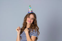 Smiling woman in celebration cap Stock Photography