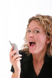 Smiling woman on cell phone Royalty Free Stock Images