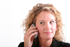 Smiling woman on cell phone Stock Image