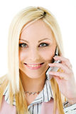 Smiling woman on cell phone Royalty Free Stock Photography