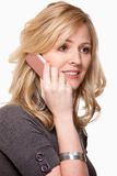 Smiling woman on cell phone. Close up of face of an attractive blond woman holding a pink cell phone over white smiling stock photo