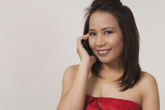 Smiling woman on cell phone Stock Images