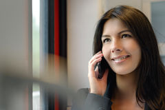 Smiling woman with cell phone Royalty Free Stock Image